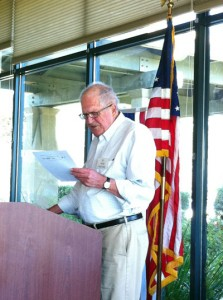 man reading a speech
